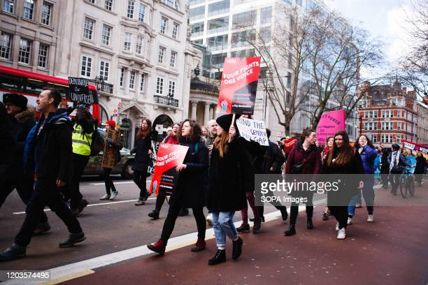 Members and supporters of the University and College Union march along Kingsway as they take part during the strike. The UCU launched a 14-day strike...