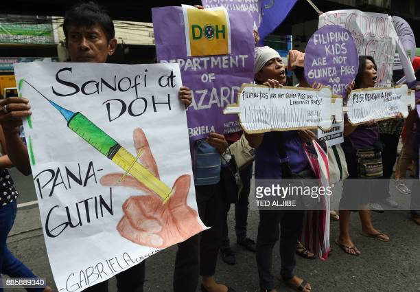 Members and supporters of the women's group called Gabriela display placards and shout slogans during a rally in front of the Department of Health...
