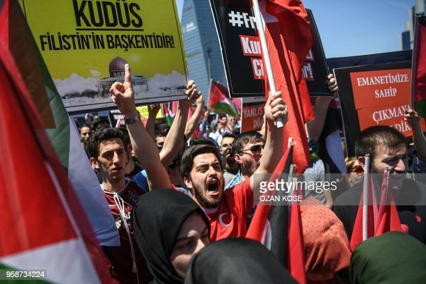 Members and supporters of Turkey's ruling party Justice and developments Party wave Palestinians and Turkish flags and hold placards reading 'AlQuds...