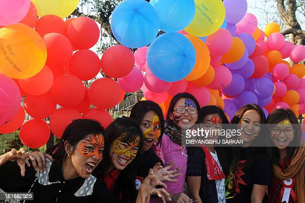 Members and supporters of various sexual minority groups enjoy a moment during a protest meeting against all forms of physical and mental violence...