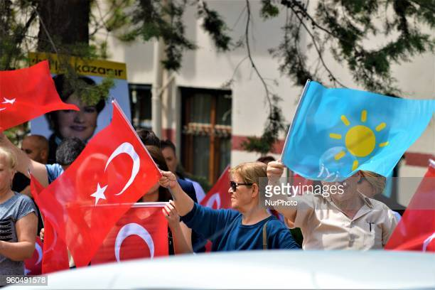 Members and supporters wave party flags and Turkish flags during a rally in support of Meral Aksener presidential candidate and the leader of the...