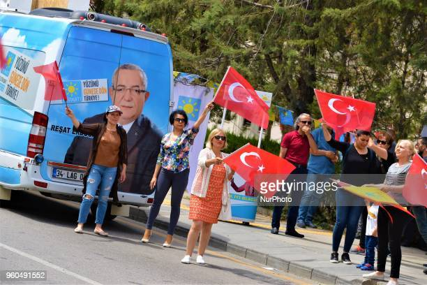 Members and supporters wave Turkish flags during a rally in support of Meral Aksener presidential candidate and the leader of the opposition IYI...