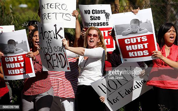SEIU members and their supporters rally Tuesday Mar 31 outside LAUSD headquarters in downtown Los Angeles Protesters called on the district to use...