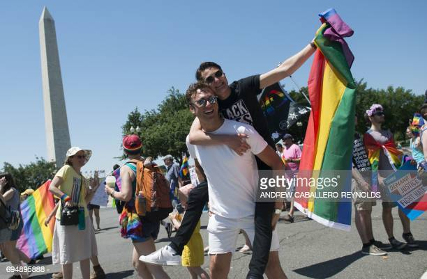 LGBT members and their supporters take part of the Equality March for Unity Pride parade near the Washington monument in Washington DC June 11 2017 /...