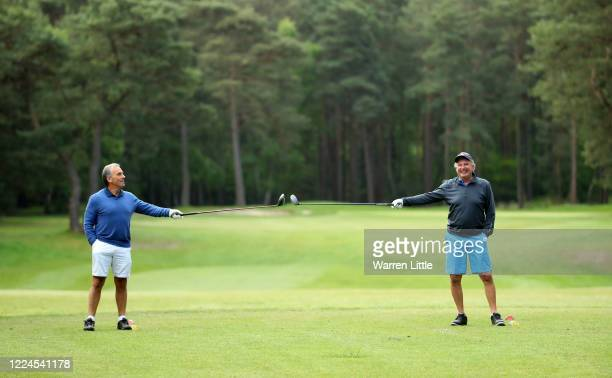 Members at Pine Ridge Golf Club ensure the 2 meter social distance as they begin their round as golf resumes in England under government guidelines...