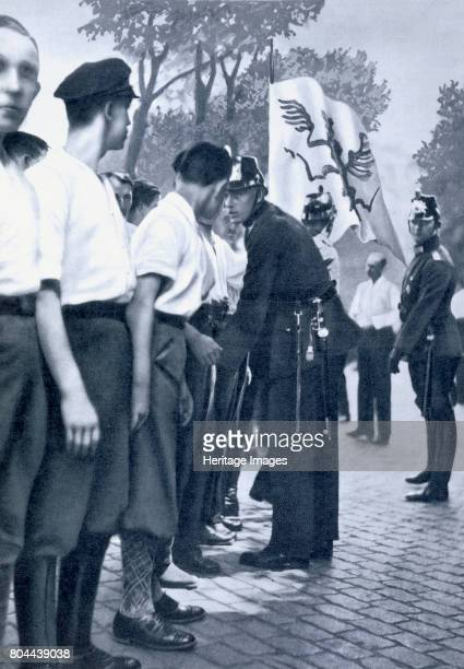 Members being searched by the police in Berlin, c1920-1933. The paramilitary wing of the Nazi Party, the SA were often involved in violence at...