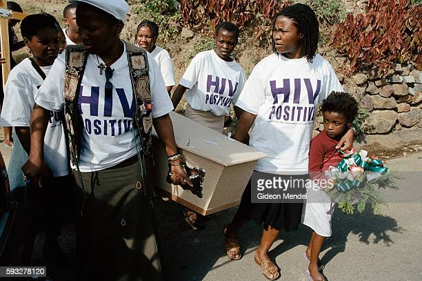 TAC members carry the coffin of Ncane Surprise Xulu a fellow TAC activist who had not received antiretroviral therapy and died of AIDSrelated...