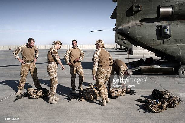 Members check their equipment at the flight line in Camp Bastion on November 28, 2009 in Helmand Province, Afghanistan. The two Medical Emergency...