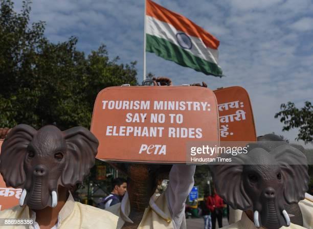 PETA members dressed as elephants in Modi jackets kurtas request Tourism Ministry to ban Elephant Rides at Rajiv Chowk Gate No 6 Palika Bazar on...