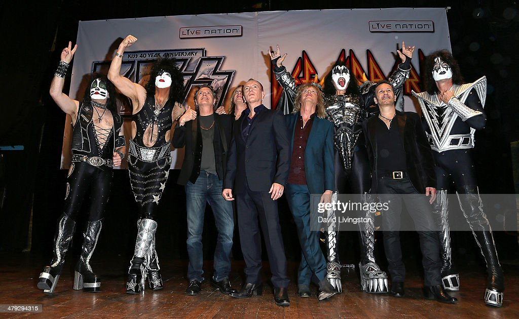 KISS members Eric Singer and Paul Stanley, Def Leppard members Rick Allen, Joe Elliot, Phil Collen and Rick Savage, KISS member Gene Simmons, Def Leppard member Vivian Campbell and KISS member Tommy Thayer pose on stage at the KISS and Def Leppard press announcement at House of Blues on March 17, 2014 in Los Angeles, California.