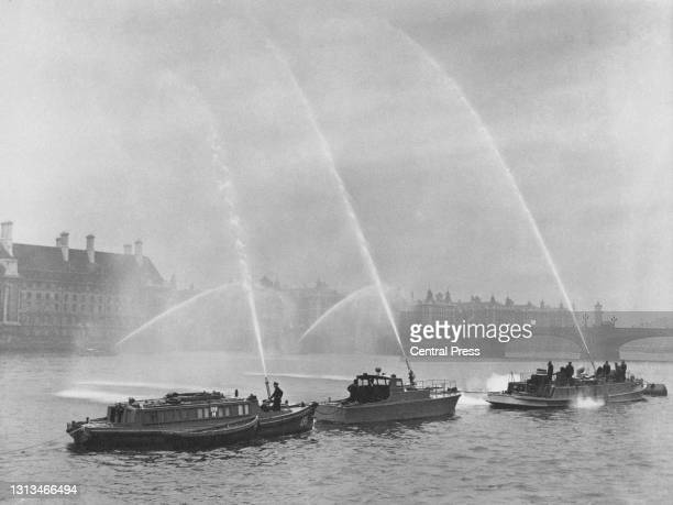 Members for the Auxiliary Fire Service and the London Fire Brigade undergo training on the River Thames at Westminster, using traversable powered...