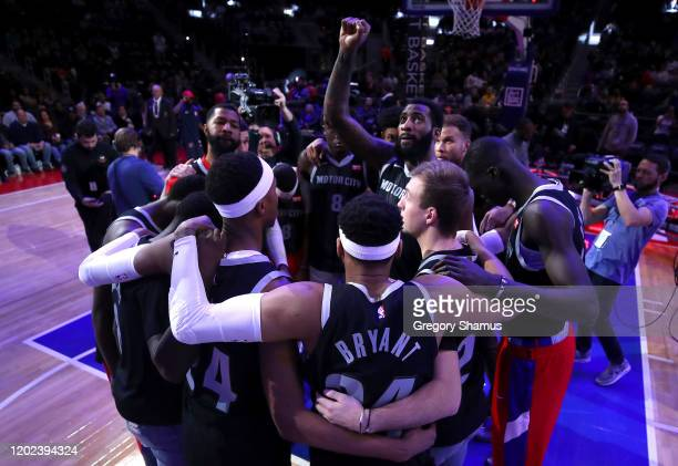 Members for the Detroit Pistons honor former Los Angeles Laker Kobe Bryant by wearing 8 and 24 jerseys as Andre Drummond looks to the sky prior to...
