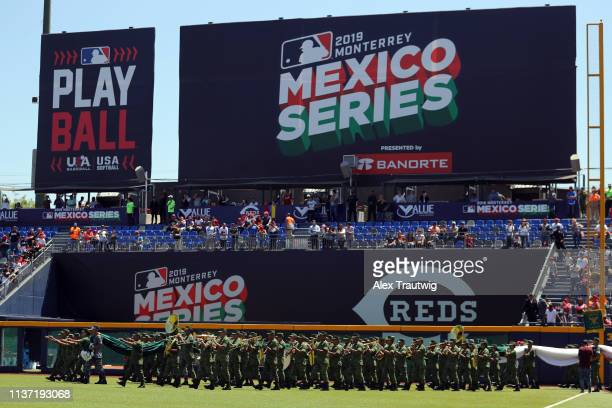 Members for the Mexican Military walk onto the field holding a giant flag during the pregame ceremony prior to the game between the St Louis...