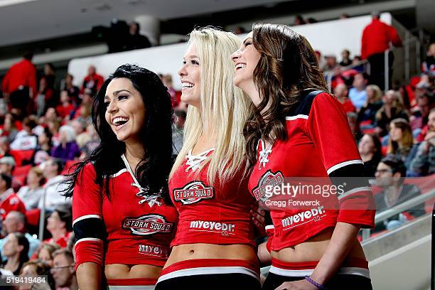 Members for the storm squad react to entertainment on the video board during an NHL game betwee the Carolina Hurricanes and the New Jersey Devils at...