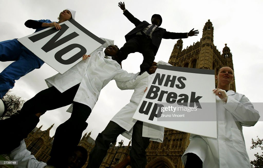 UNISON members form a human pyramid in front of the Houses of Parliament to protest against Foundation Hospitals on November 18, 2003 in London. Unison are protesting about current conditions which will turn the NHS into a two tier system.
