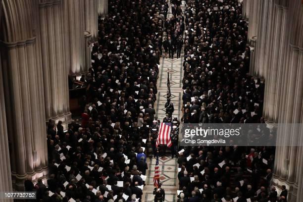 Members former President George H.W. Bush's family, including former President George W. Bush and former Florida Governor Jeb Bush, follow his casket...