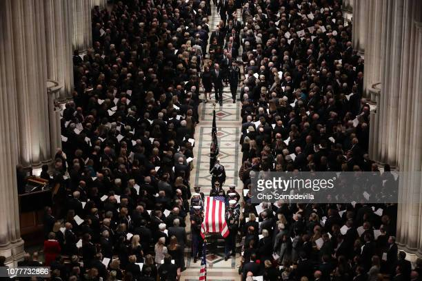 Members former President George HW Bush's family including former President George W Bush and former Florida Governor Jeb Bush follow his casket out...