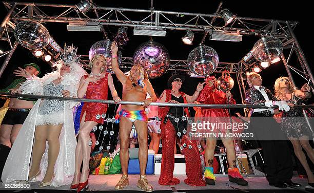 Members from Australia's oldest gay social group 'Pollys' dance under mirrorballs during the 31st annual Gay and Lesbian Mardi Gras parade through...