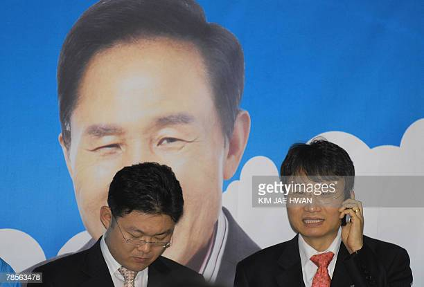 Members from South Korea's Grand National Party wait for the first exit results of the presidential election to be broadcast 19 December 2007 at the...