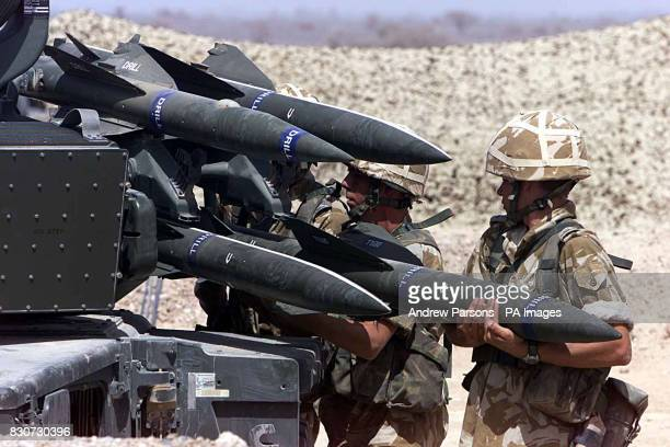 Members from the 26 Squadron RAF Regiment load a Rapier field Standard C Launcher with surface to air missiles while on exercise in the desert of...