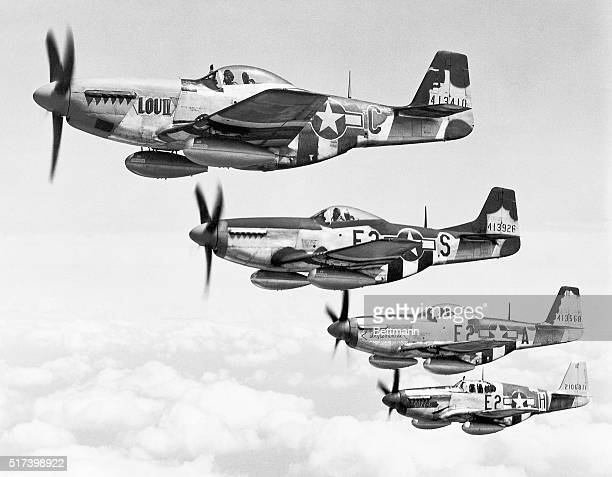 Members from the 375th Fighter Squadron of the 361st Fighter Group fly their P-51 Mustangs over England. | Location: Near England, UK.