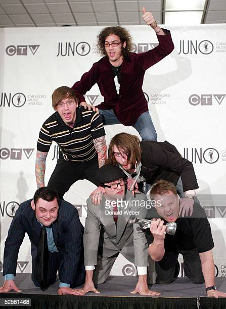 Members from the band Alexisonfire accept their Juno backstage for Best new Group of the Year during the Juno Awards Dinner and Gala on April 2 2005...