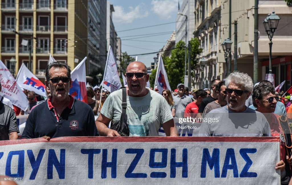 Members from the communist-affiliated trade union PAME chant slogans during a rally against austerity measures in Athens, Greece, Thursday June 14, 2018