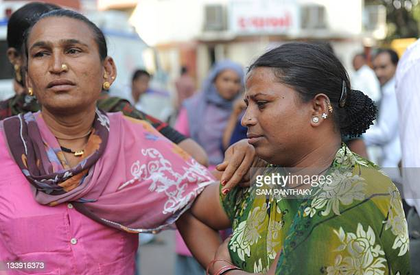 Members from the eunuch community react at the VS hospital, as patients arrive from New Delhi's GTV hospital, in Ahmedabad on November 22, 2011. Two...