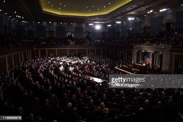 Members from the House of Representatives with most Democratic ladies wearing white listen to US president Donald Trump deliver the State of the...