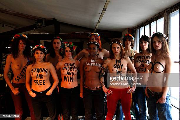 Members from the topless women's rights group FEMEN pause in their 'training camp' at the Lavoir Moderne Parisien in Paris FEMEN has chosen Paris to...
