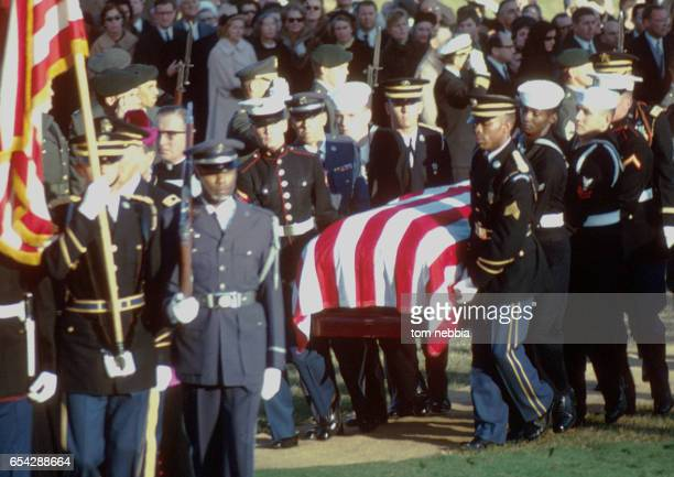 Members from the various US military services carry President John F Kennedy's flagcovered casket to his burial at Arlington National Cemetery...