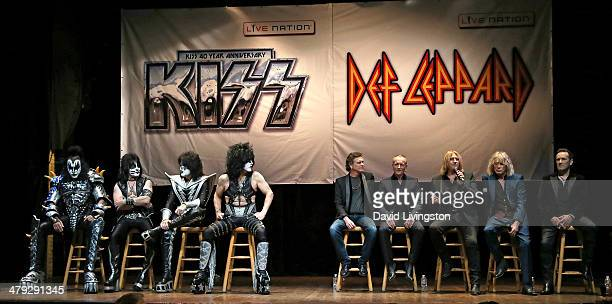 KISS members Gene Simmons Eric Singer Tommy Thayer and Paul Stanley appear on stage with Def Leppard members Rick Allen Phil Collen Joe Elliot Rick...