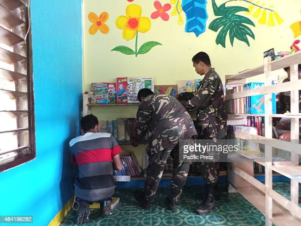CAFGU members in South Cotabato helps in building a library in Salacafe village in T'boli South Cotabato in Mindanao Citizen Armed Force Geographical...