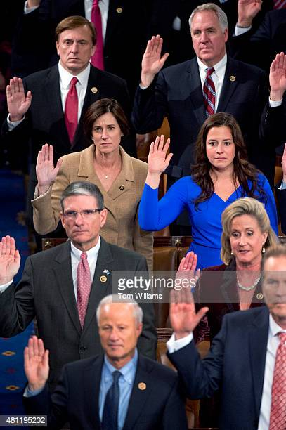Members including Reps Elise Stefanik RNY in blue and Mimi Walters RCalif left are sworn in to the 114th Congress on the House floor January 6 2015
