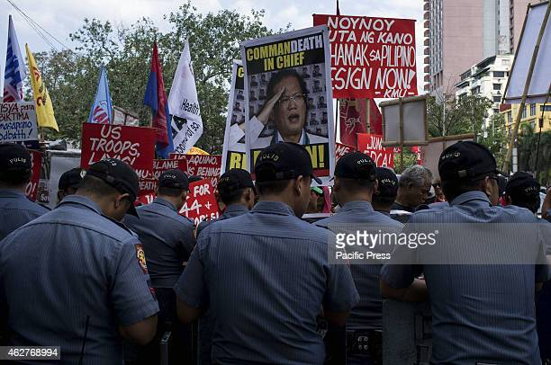 MANILA PHILIPPINES MANILA PHILIPPINES PNP members line to prevent militant groups from entering the main gate of the US Embassy during a protest...