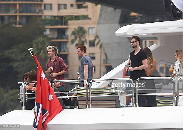 Members Louis Tomlinson Niall Horan and Liam Payne of boy band 'One Direction' cruising on a $26 million luxury boat on Sydney Harbour on February 8...