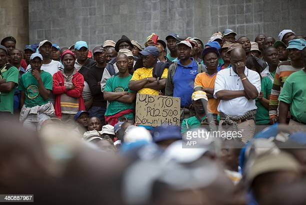 members march in Johannesburg on March 27 2014 during a demonstration where its President delivered a memorandum to the main Platinum producers In...
