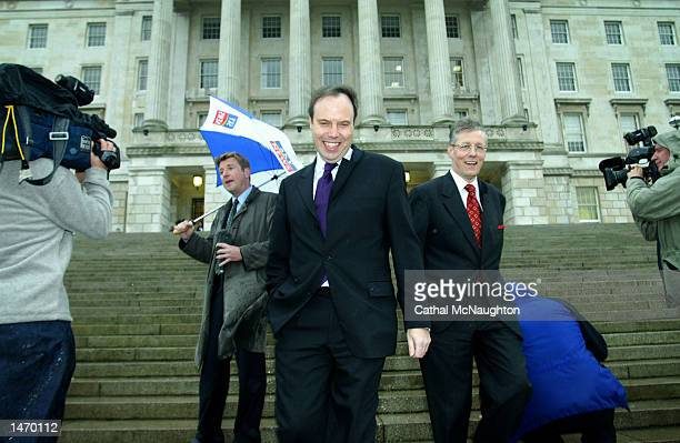 Members Nigel Dodds and Peter Robinson leave the Parliament building October 11, 2002 in Belfast, Northern Ireland. Regional Development Minister...