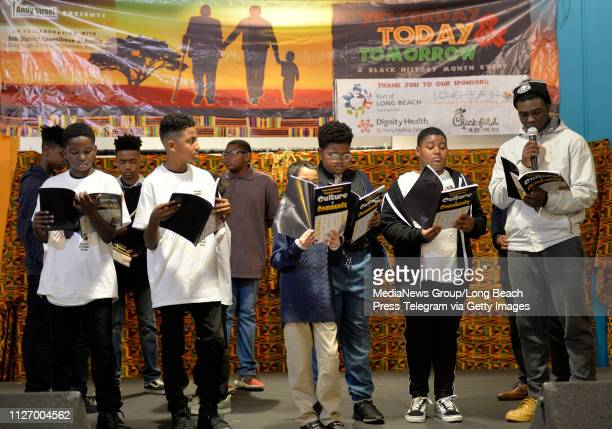 Members of 100 Black Men of Long Beach Inc read from a graphic novel entitled Culture Community during the seventh annual celebration of Yesterday...
