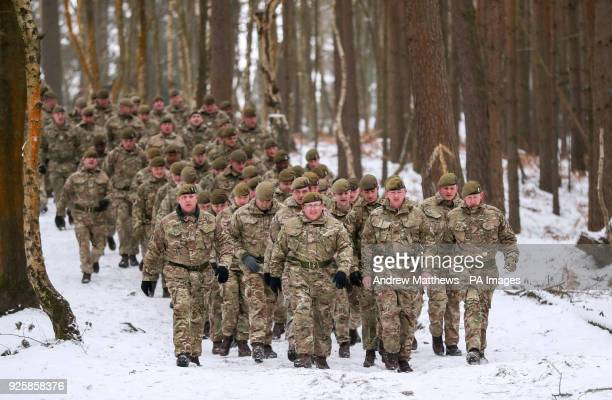 Members of 1st Battalion Welsh Guards make their way from their barrakcs to the combined St David's Day celebration and predeployment service at...