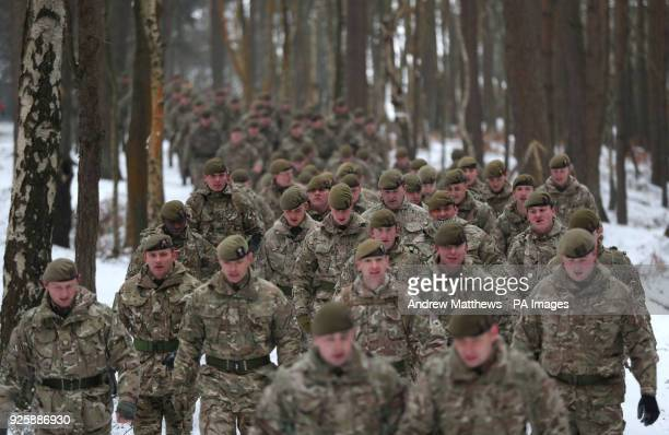 Members of 1st Battalion Welsh Guards make their way from their barracks to the combined St David's Day celebration and predeployment service at...