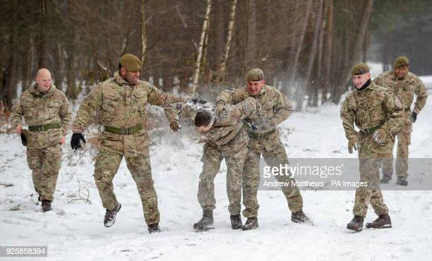 Members of 1st Battalion Welsh Guards take part in a snow ball fight prior to the combined St David's Day celebration and predeployment service at...
