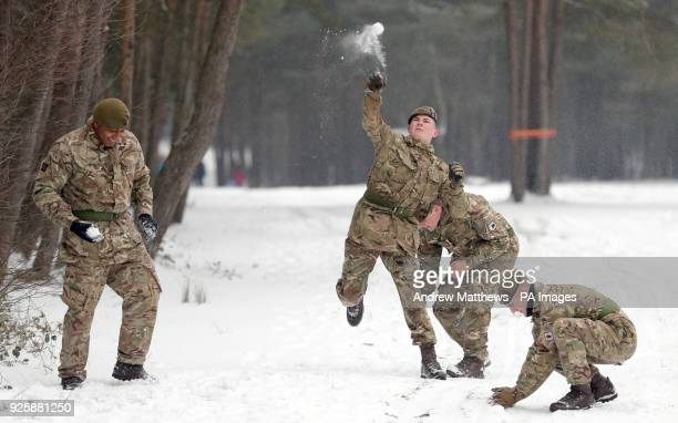 Members of 1st Battalion Welsh Guards take part in a snow ball fight before the combined St David's Day celebration and predeployment service at...