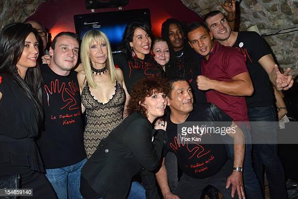 Members of '2 Mains Rouges' AntiAIDS association team attend the 'Les 10 Ans de Marc Mitonne' Party Hosted by '2 Mains Rouges' at the Marc Mitonne...