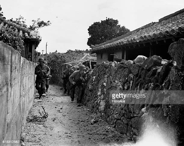 Members of 306 Infantry 1st Battalion 77th Division in the hills on Geruma Shima in the Keramas Islands stalking snipers after the US invasion...