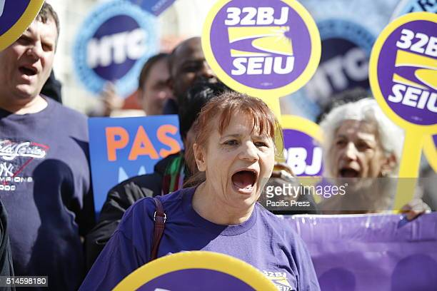 Members of 32 BJ of the Service Employees International Union 1199 chant NYC mayor Bill de Blasio highlighted a rally on the city hall steps...