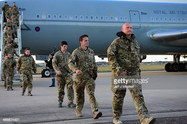 Members of 617 Squadron the Dambusters arrive back at RAF Lossiemouth from Afghanistan on February 4 2014 in Lossiemouth Scotland The RAF's 617...
