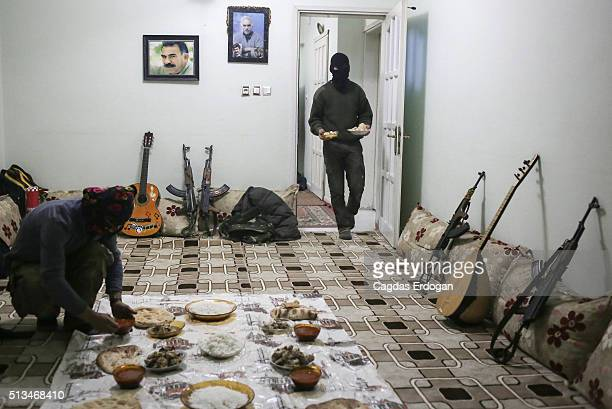 Members of a armed group Patriotic Revolutionary Youth Movement a youth division of the Kurdistan Workers' Party PKK prepare their dinner a house in...