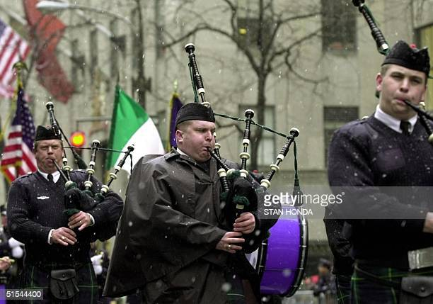 Members of a bagpipe band make their way up Fifth Avenue on 17 March 2000 in New York during the 239th annual St Patrick's Day parade Temperatures...