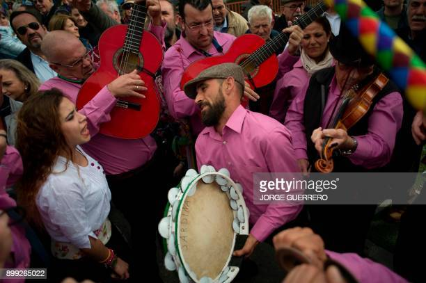 Members of a band or 'panda' perform during a rehearsal before taking part in a traditional Verdiales Flamenco contest in Malaga on December 28 2017...